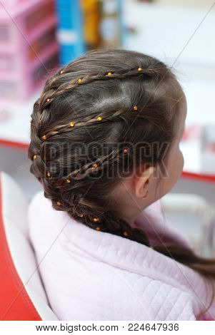 Barbershop. Hairdressing Salon. Hairstyle Hair Braided little girl