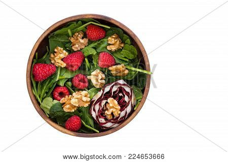 High angle view of bowl with healthy fruit salad isolated against white background