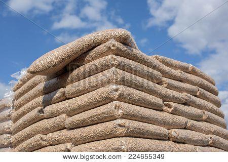 Heap of bags with wooden pellet biomass