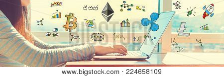 Cryptocurrency with woman working on a laptop in brightly lit room