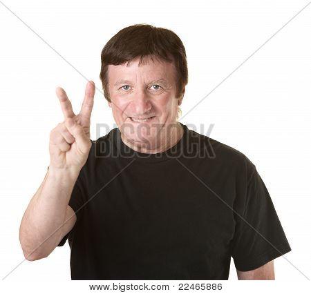 Man Shows Victory Symbol