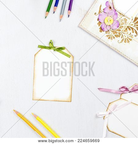 Scrapbook elements and decor on white rustic background, copy space. Top view