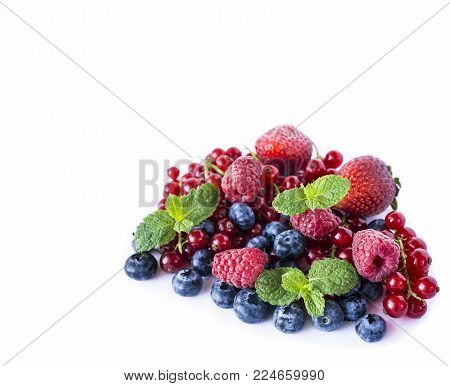 Mix berries isolated on a white. Ripe blueberries, red currants, raspberries and strawberries. Various fresh summer berries on white background. Berries and fruits with copy space for text. Background berries.