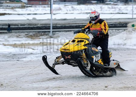 Tyumen, Russia - March 08. 2008: IV stage of personal-team Championship of Ural Federal district in over-snow cross-country. Sport racing of ski mobile rider at winter day