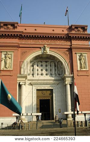 Cairo, Egypt - November 11, 2006: The Egyptian Museum in Cairo, one of the most famous museums of the world. Tourists come through the main entrance into the museum.
