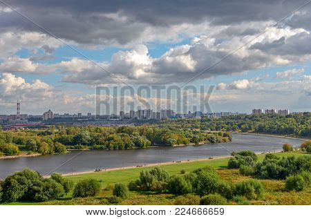 Moscow Cityscape With River, Park And Cloudy Sky