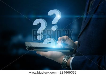 Businessman answering questions in the tablet computer.