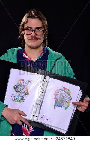 Tattoo artist show his arts design portfolio.