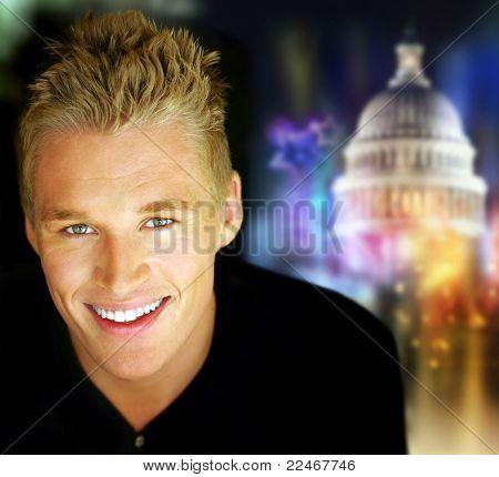 Porträt eines jungen Mannes der lächelnd vor abstrakten politischen Hintergrund festlich