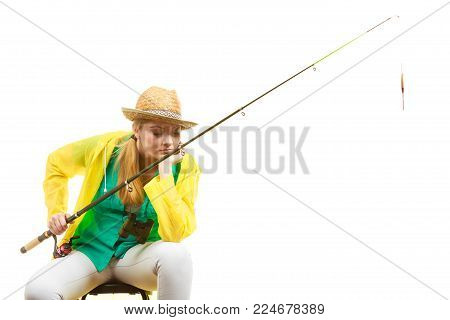 Fishery, spinning equipment, angling sport and activity concept. Bored woman with fishing rod, waiting for fish to hunt.