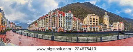 SOCHI, RUSSIA - APRIL 20, 2015: Embankment of the river Mzymta of Rosa Khutor resortskiers and lovers of a healthy lifestyle