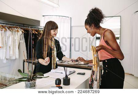 Female Fashion Designer Designing Clothes In Her Fashion Design