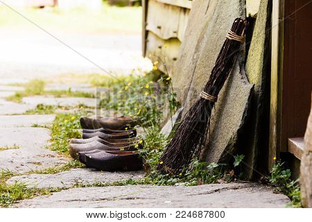 Regional tradition and culture, handmade concept. Wooden dutch shoes, traditional clogs footwear standing in row