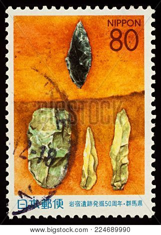 Moscow, Russia - February 01, 2018: A stamp printed in Japan shows artefacts from Iwajuku paleolithic site, series