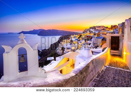 Church bells on a Greek Orthodox Church overlooking the Aegean Sea in the town of Oia on the island of Santorini in the Cyclades off the coast of mainland Greece.