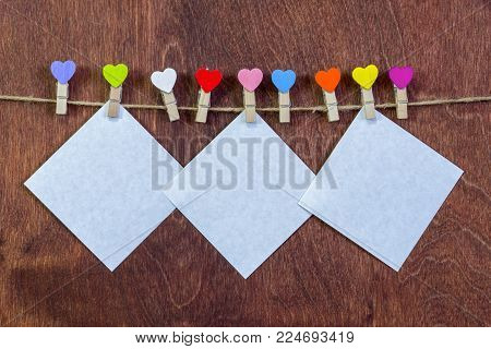 Female hands take out a letter from a red envelope. Valentine's Day. Love, relationships.