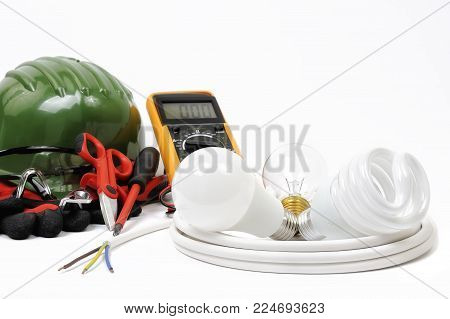 Safety equipment, work tools and components for a residential electrical installation, photographed on a white background.