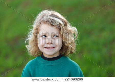 Small child with long blond hair enjoying of a sunny day