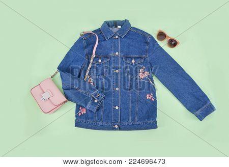 blue Embroidered flowers,bird,bird jacket jeans ,sunglasses, handbag -  green background