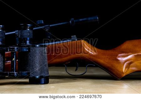 Shooting Accessories On A Wooden Table In A Shooting Range. Shield And Projectiles For Pneumatic Wea