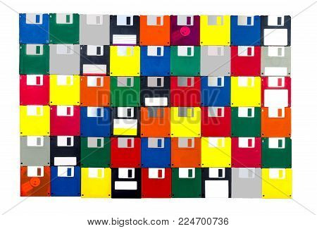 Horizontal shot of a group of multicolored plastic diskettes laid into a solid background.  All fronts.  White background.