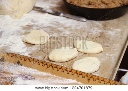 Old Woman Baking Pies In Her Home Kitchen. Grandma Cooks Pies. Home Cooked Food. Omemade Mold Cakes