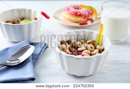 Cereal with gummy worms in bowl. April fools food