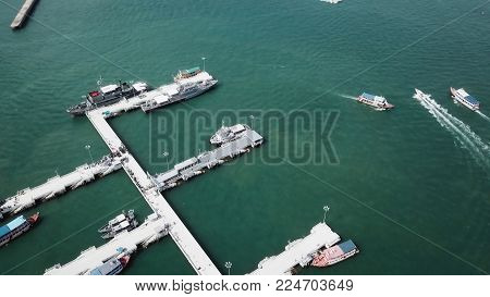 Top view Marine station private speed boats seaport in Marine station complex , Pattaya City Chonburi province, landscape Thailand. Aerial view of Tour port in Pattaya, Thailand