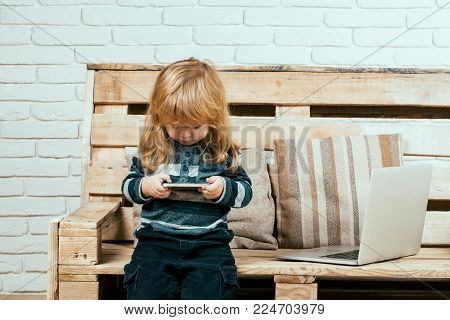 Social Network And New Technology. Child With Laptop And Mobile Phone, Education. School And Communi