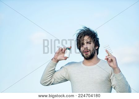 Man With Pills In Jar And Blister Pack. Drug And Antidepressant, Insomnia. Health And Medicine, Hang
