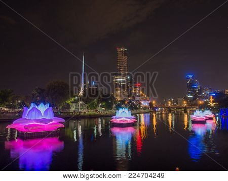 AUSTRALIA, MELBOURNE - February 22, 2015: Melbourne City and Yarra River with colorful illuminated decorations at Night