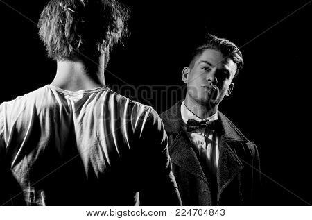 Two Handsome Men Standing Opposite On Black Background. Businessman In Classic Bow Tie, Shirt And Da