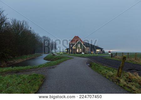 Traditional Dutch farm in the polder landscape of Marken, The Netherlands.