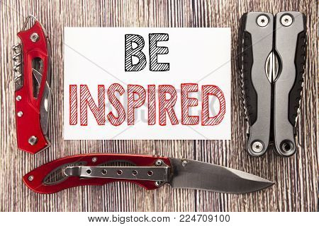 Conceptual hand writing text caption inspiration showing Be Inspired. Business concept for Inspiration and Motivation written on old wooden background with pocket knife with space