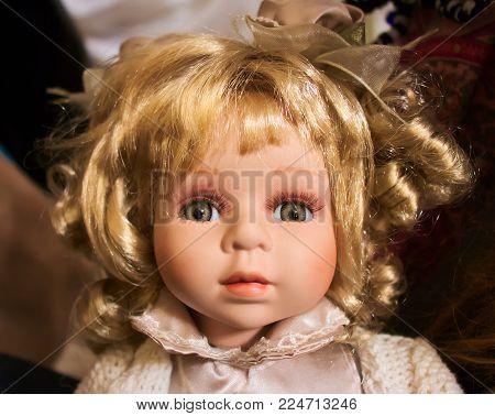 Blonde baby doll, grey eyes, chubby cheecks, fringe hair