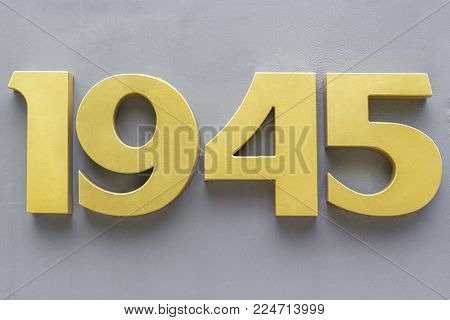 Volumetric metal numbers 1945 on a gray background. 1945 - the end of the Great Patriotic War.