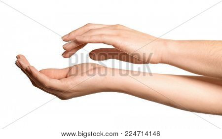 Hands of young woman with healthy skin softened by cream with moisturizing effect, on white background