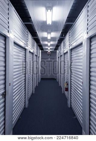 Indoor hallway of steel storage locker units.