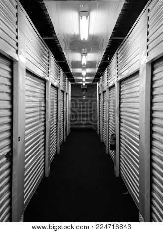 Indoor storage locker units looking down the hallway.