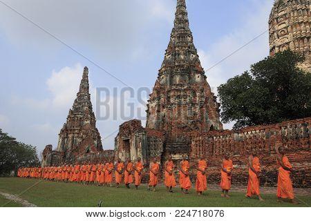 Ayutthaya, Thailand - Feb 12, 2010: The monks walking in a row in Wat Chai Watthanaram (known as Mini Angkor Wat), ayutthaya historical park, on Feb 12, 2010.