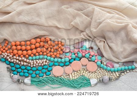 Set of vintage costume jewellery beads, necklaces, bracelets, scarf. Top view flat lay