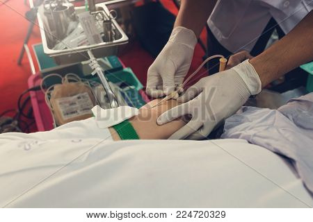 Nurse Receiving Blood From Blood Donor In Hospital.
