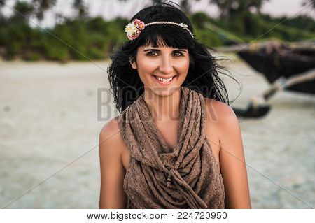 Beautiful girl hippie looks at you and smiles