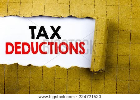 Word, writing Tax Deductions. Business concept for Finance Incoming Tax Money Deduction written on white paper on yellow folded paper.