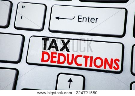 Writing text showing Tax Deductions. Business concept for Finance Incoming Tax Money Deduction written on white keyboard key with copy space. Top view