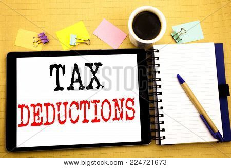Tax Deductions. Business concept for Finance Incoming Tax Money Deduction Written on tablet, wooden background with sticky note and pen