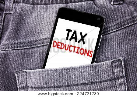 Conceptual hand writing text caption showing Tax Deductions. Business concept for Finance Incoming Tax Money Deduction written mobile cell phone with space in the back pants trousers pocket