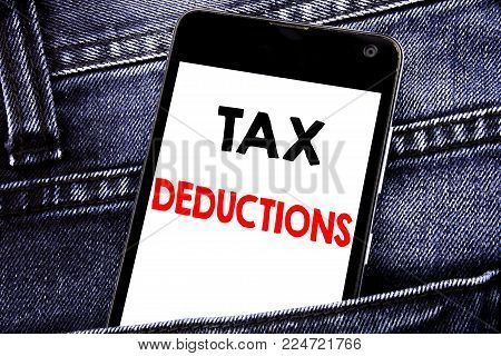 Writing text showing Tax Deductions. Business concept for Finance Incoming Tax Money Deduction written mobile cell phone with space in the back pants trousers pocket