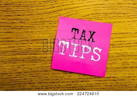 Handwriting Announcement text showing Tax Tips. Business concept for Taxpayer Assistance Refund Reimbursement written on sticky note empty paper, background with copy space, sunglasses.