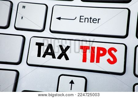 Writing text showing Tax Tips. Business concept for Taxpayer Assistance Refund Reimbursement written on white keyboard key with copy space. Top view